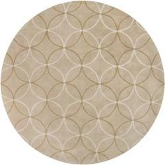 @Overstock - This round, hand-tufted rug is finely crafted of poly-acrylic materials. A brown and ivory geometric design highlight this beige colored rug.http://www.overstock.com/Home-Garden/Hand-tufted-Retro-Chic-Beige-Rug-8-Round/5649018/product.html?CID=214117 $321.99
