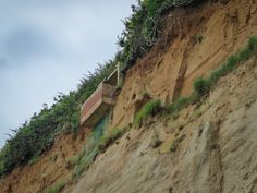 "https://flic.kr/p/JjwReR | Sandown to Shanklin #4 | The seafront path from Sandown to Shanklin on the Isle of Wight will take you under some towering cliffs that are prone to rock falls.  This I believe was once a viewpoint but as you can see the cliff has been eroded from underneath and is now no longer safe to use.  Didn't take my Nikons on holiday this year just my little Panasonic TZ70. Shot everything in Jpeg on Intelligent Auto just for the convenience of it. This was not a ""photo..."