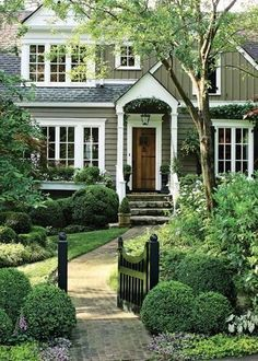 Beautiful home inspiration - classic, traditional style exterior home with small entry porch, steep roofline and bright white trim.