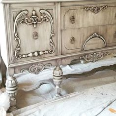 This sideboard was paint with French Linen then I mixed Silo into our Oil Wax and used it wiped it down to create an oil painted look. Our black and pearl waxes were used along with some color tinting and dark antiquing wax to create a one of a kind look for a very particular client (my MIL ). She definitely pushed me out of my comfort zone!