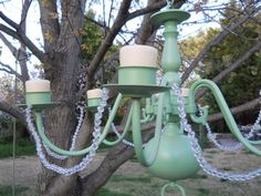 Recycle an old chandelier into an outdoor candle-lit chandelier.