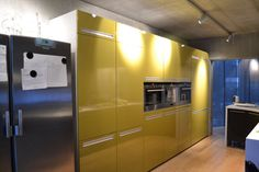 Beautiful acid yellow kitchen lit with Martini light spots on a 230V track.   This look is decidedly industrial, but looks totally right in my client's home. You should have some ceiling height though..