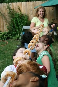 Use one long piece of string and string 10-12 donuts through it. Have two adults hold each end of the string and hold it above the kids head. Space out the donuts and have the kids try eating the donuts with their hands behind their backs and using just their mouths.   best stuff