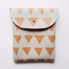 LEATHER POUCH // ivory leather with flesh tinted m triangles. $28.00, via Etsy.