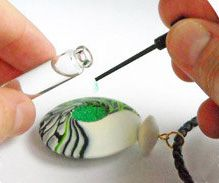 Polymer Clay Daily – this jewelry has a secret compartment. Maxim drills a shallow hole in the back of the swirled bicone bead where a few drops of perfume can be added. The design is meant to help those who can't tolerate perfume on their skin.