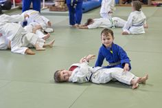 """Kids who train Brazilian Jiu Jitsu at Revolution MMA in Benton AR get more than just """"martial arts training"""": They make friends, learn life skills, and so much more. Secure your child's trial now by calling 501-776-0606"""