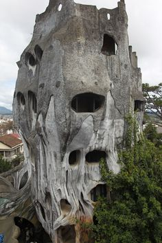 "Hằng Nga guesthouse, popularly known as the ""Crazy House"" was designed and constructed by Vietnamese architect Dang Viet Nga. It has been open to the public since 1990, Described as a ""fairy tale house"", the building's overall design resembles a giant tree, incorporating sculptured design elements representing natural forms such as animals, mushrooms, spider webs and caves."