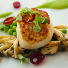 Pan-roasted Scallops by Aura Restaurant at Seaport Boston Hotel, via Flickr.
