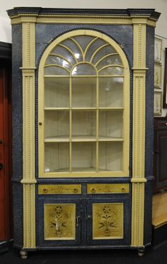 Pennsylvania painted pine architectural corner cupboard, 19th c., retaining a later painted surface,