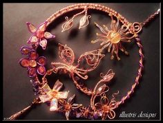 Large purple/copper suncatcher with butterfly door illustrisdesigns