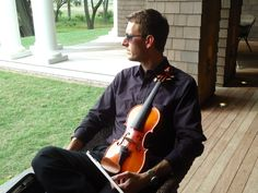 Ben Weiss, violinist for Charleston Flutist, LLC, enjoys watching the wedding ceremony at the beautiful Ocean River Course on Kiawah Island in SC.