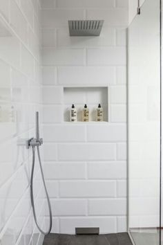white beveled subway tile white grout white penny tile accent in niche