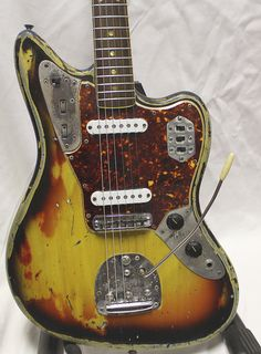 Years of playing eroded that paint and now there's the soul of an artist in every scratch you see. Don't choke it, let it breathe with you. 1965 Fender Jaguar Sunbust with Duncan pickups