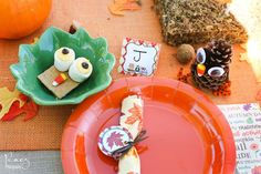 Fun place settings at the kid's table at a Thanksgiving party!  See more party planning ideas at CatchMyParty.com!