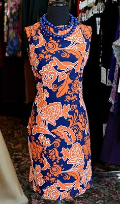 Florida Gator Dress. An elegant twist on the quintessential sheath dress. A stunning high neck line and glamorous fit makes this style perfect for day-to-night dressing. Fabric content: nylon/spandex.