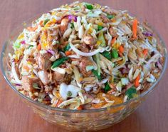 Oriental chicken salad with mandarin oranges, cabbage, bean sprouts, almonds and tangy dressing.
