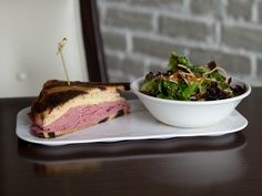 Our Chef's Monthly Sandwich for January, as featured in our lunch entrée The Relationship, is a Reuben Sandwich with corned beef, Swiss cheese, sauerkraut, and Thousand Island dressing paired with Market Green Salad with shaved squash and tomato vinaigrette.