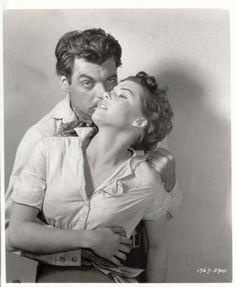 FOUR GUNS TO THE BORDER (1954) - Rory Calhoun embraces Lisa Gay - Universal-International - Publicity Still.