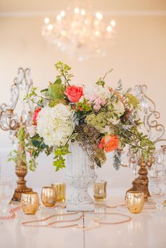 Eclectic Centerpiece with Antiqued Candelabras + Crystals -- See more wedding decor inspiration on #SMP here: http://www.StyleMePretty.com/north-carolina-weddings/charlotte/2014/05/13/romantic-wedding-inspiration-separk-mansion/ Floral Design: ChelishMoore.com - Casey Hendrickson Photography: CaseyHPhotos.com