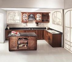 Island Wooden modular Kitchen from nano Kitchen and Interiors :Ph:9349101300