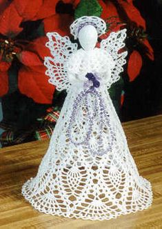 $$$... Pineapple Cascade Angel...  top your tree or mantel with this gorgeous crochet pineapple angel. trimmed with a full pineapple skirt, matching wings & capelet trimmed with pearls. matching double pineapple wings compliment the extra full triple row pineapple skirt.