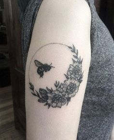 The Grey Bee Buzzing Around Flowers. Bees love flowers. And this love is perfectly depicted in this tattoo design.