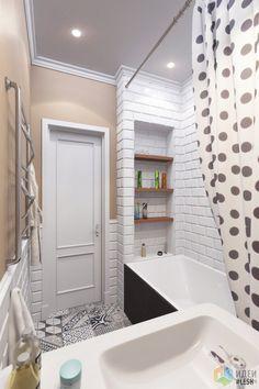 Сочетание черного и белого выглядит стильно и элегантно. А чтобы ванная комната не казалась слишком мрачной, часть стен были покрыты декоративной штукатуркой яркого цвета.  Другие способы оформления этого проекта и интересные решения дизайнеров смотрите на нашем сайте.