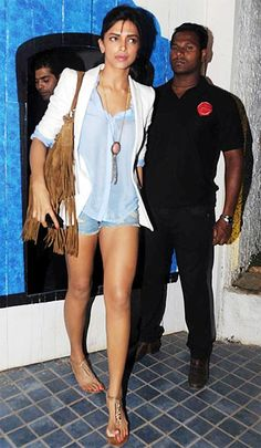 Deepika Padukone pulled out all stops with a white blazer and distressed denim shorts. #Bollywood #Fashion