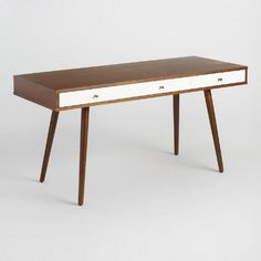 With a clean, minimal profile and splayed legs, our wooden two-color desk is a retro workspace with three drawers for storage and plenty of mid-century style to spare. This versatile piece is perfect in the home office or as an accent table in the living room or entryway.