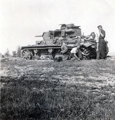 Wehrmacht Panzer III number 731 undergoing maintenance by its crew on the Russian Front in 1942. Looks like it is from the 17th Panzer Division by the symbol on the hull to the right of the Balkenkreuz