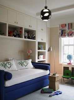 boy - Katie Ridder: Chic boy's room with white built-ins cabinets shelves, royal blue velvet daybed, white & ...