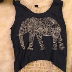 Elephant blue and white crochet crop top This is a perfect spring and summer top. It's not quite a crop top, but is a shorter top. Cute with high waisted shorts or jeans. Tops Crop Tops