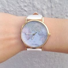 Around the world leather watch Got this a couple months ago and I don't like the way it looks on me :( actually sad to let this go because it's super stylish, is white leather, and will easily pair with any outfit! Not from UO but it pretty much looks exactly the same. Price is firm Urban Outfitters Accessories Watches