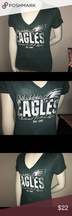 "Women's Philidelphia Eagles graphic T-shirt sz: M Thank you for viewing my listing, for sale is a women's, NFL official apparel, Philadelphia eagles, short sleeve, graphic T-shirt   Sz: M   Brand: NFL women's apparel   If you have any questions or would like additional photos please feel free to ask.   From under one arm to under the other measures appx 18"" from the top of the shoulder to the bottom of the shirt measures appx 25"" nfl Tops Tees - Short Sleeve"