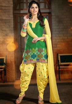 A striking Green & Yellow Color Cotton Designer Patiala Salwar Kameez featuring a embroidered yoke, sleeves and border
