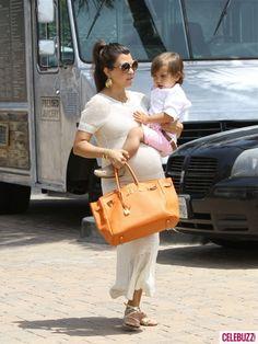 Pregnant Kourtney Kardashian balances baby Mason on her bump! Too cute