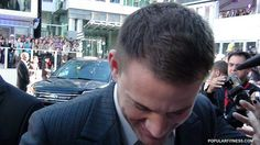 Close-up of Channing Tatum signing an autograph at Toronto film festival - TIFF