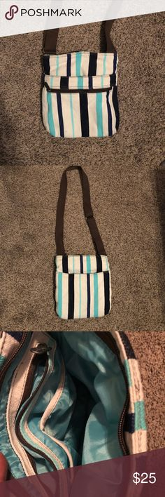 Thirty one crossbody Cute deep blue , cream, and teal strips ! Great condition ! Brown suppers and handle ! Small stain not noticeable ! thirty -One Bags Crossbody Bags