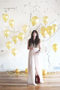 Use cardstock and weighted balloons to make this simple backdrop.