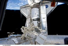 Discovery Visits the Space Station  Credit: Space Shuttle STS-133 Crew, Space Station Expedition 26 Crew, NASA