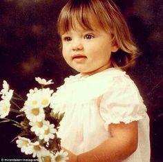 Miranda Kerr. She looks alot like the little girl I babysit. Especially the eyes! so cute.