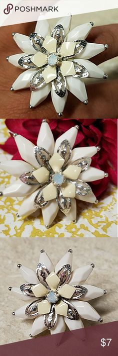 """Chunky Spiked Flower w/ Opal Stretch Ring Super Cute faceted ivory spike style petals capture light with movement. At the center of the 11 petals, there is 2 layers of decorative silver & ivory enameled flowers, and a central opal. Just over 1.5"""" with silver stretch band to fit most fingers. Designed by BOHM NY.  R301 🛍25% OFF BUNDLES OF 3 📦BIG BUNDLES = BIG SAVINGS💰 Simply bundle & send message ✔REASONABLE OFFERS ACCEPTED Jesi's Fashionz Jewelry Rings"""
