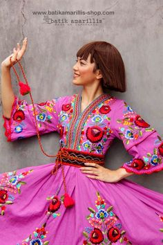 Batik Amarillis made in Indonesia proudly presents batik amarillis's amarantha dress in  full Hungarian embroidery inspired  on cotton linen blend also features beautiful Smocked neckline and waistband plus gorgeous crocheted around the sleeves , We maintain its distinct modern-bohemia, modest & unabashedly romantic. slimming silhouette with its tiered bell sleeves plus full skirt for ethereal head-turning approach to occasion dressing