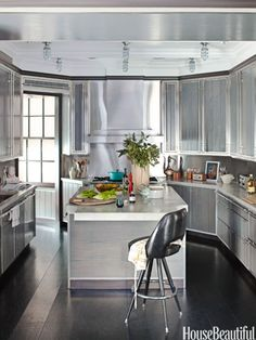 Sleek as a speedboat, this New York City kitchen designed by Anik Pearson is intricately detailed with gleaming wood and maritime hardware.