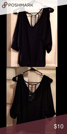 "Black open back dressy blouse Loose fit black blouse. Long ""open/slit"" sleeves. Open back with silver and gold embellishments. Make an offer! Willing to bundle! Forever 21 Tops Blouses"