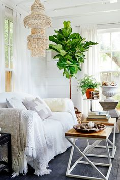 Make your ordinary sofa extraordinary with a beautiful white quilt! Layering a sofa with blankets and pillows in various shades of white makes it look cozy and welcoming. And for the stain-prone, white sofas are not out-of-bounds if you cover the furniture in machine-washable throws and pillows.