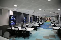 The University of Western Australia created three collabrative teaching spaces that can also be opened up by using folding glass walls to form one large collabrative space.