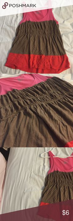 Pink, Brown, and Orange Tank Top This is a tank top that has 3 colors, orange, pink, and brown. It is synched at the brown strip which makes it look very flattering on the stomach. Worn a few times but is in great condition Tops Tank Tops