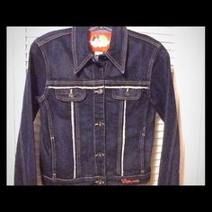 """HOST PICK- """"FIONUCCI"""" GORGEOUS BLUE JEAN JACKET A beautiful dark blue detailed blue jean jacket.  Four pockets in front. Two pockets on chest and two side pockets. Embroidered on back. NWOT (made in turkey) 98% cotton /3% spandex FIONUCCI Jackets & Coats Jean Jackets"""