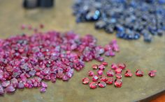 Rough and faceted Pailin rubies and sapphires. The rubies were reportedly mined near Bang Pra Lat village few kilometers from Pailin in the ...